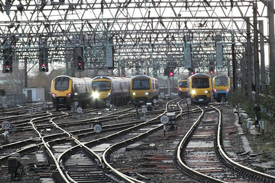Nice line up of a 221, 185, 323, 185, 323 and a 175. Manchester Piccadilly 5 December 2011