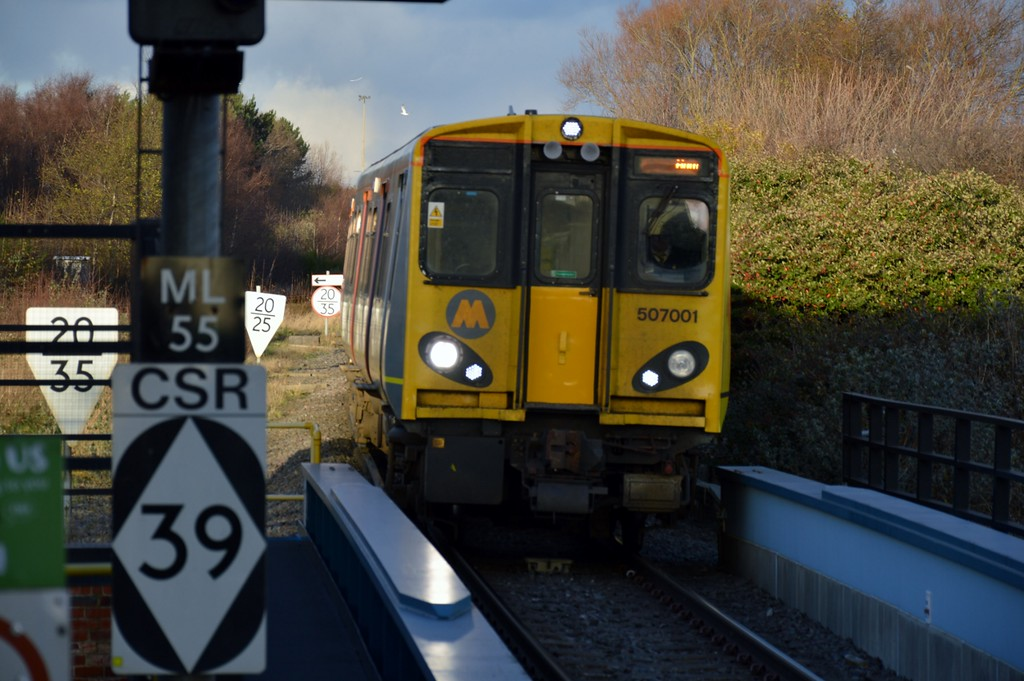 507 001 arrives at Sandhills 28 December 2017 Note the lineside signage.