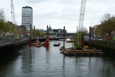 The Liffey Tour boat makes its way through the construction site of the new bridge over the river that will link Marlborough Street and Hawkins Street. If the Luas connector line is built, one track of the route will use this bridge. Saturday, 07/04/12