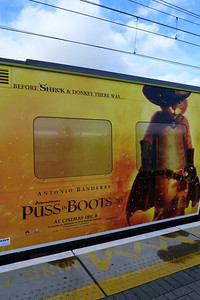 The final advertisement on a DART. Puss in Boots ads have been placed on the inner ends of two sets 8521-22 and 8523-24. Dublin Connolly, Thursday, 08/12/11