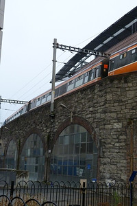 The RPSI Cravens pass between the buildings at Trinity on the Santa Special to Maynooth. Sunday 04/12/11