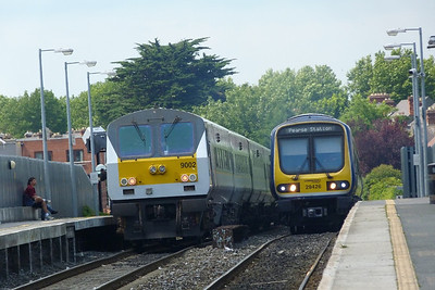 9002 on the rear passes a local Maynooth Commuter operated by 29026. Drumcondra, Thursday, 14/07/11