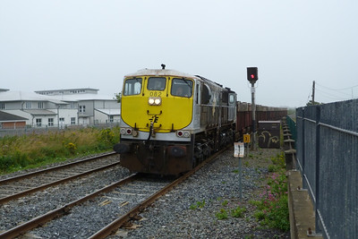 082 passes through a damp Balbriggan with the morning laden Tara Mines service to Dublin Port. Tuesday, 24/07/12