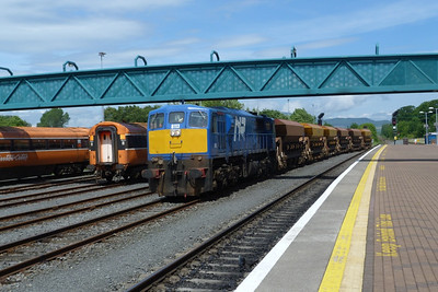 8113 leads the ballast rake into the loop, passing the Mark 3 sets, at Dundalk, Wednesday, 20/06/12
