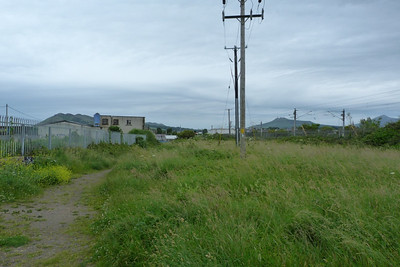 This is the view looking south along the former trackbed at Bray. The current route is seen on the right. The divergence took place at the north end of the harbour bridge. Thursday, 05/07/12