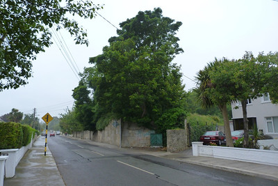 Quinn's Road in Shankill and on the right can be seen the embankment and one abutment for the bridge that crossed the route. Just after this bridge the line was diverted around 1915 away from the coastal route to the inland route. Thursday, 05/07/12