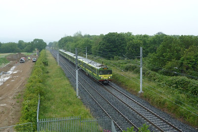 A footbridge crosses the current DART line at former Shanganagh Junction. The line trailed in on the right and joined the route near the end of the DART unit. This was the junction built around 1915 when the inland route through Shankill was built. 8107 is seen with a northbound working. Thursday, 05/07/12