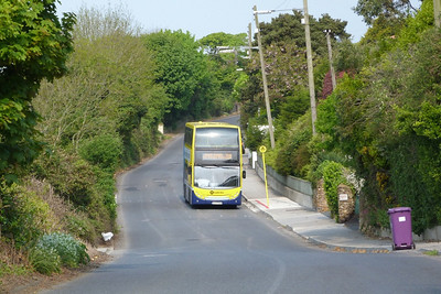 EV 15 on the 31B on the Carrickbrack Road. Following the closure of the tram line a number of replacement bus services were operated. This is the current incarnation of that service.  This piece of road is an original road which shared space with the tram line.