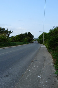 Looking along the Carrickbrack Road at St. Fintan's Cemetery. Behind the camera there was a passing loop, and further down the road where the car is there was also a passing loop. The tramline was on the left hand side of the road.