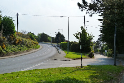 On the left is the Carrickbrack Road built on the former tram route. There was a passing loop just past the bend. On the right is Thormanby Road the original road to the summit.