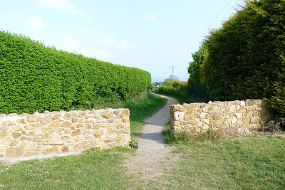 Where the path joins the road at the Summit. As mentioned the line turned towards the left hand side of the picture at the wall.