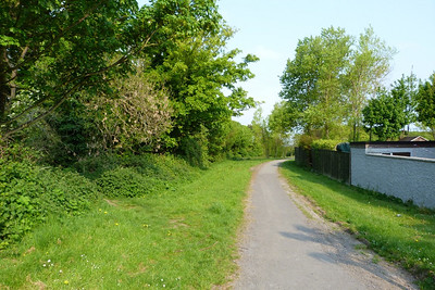 Looking down the path where it joins Grace O'Malley Drive. The tram route was off to the right, approximately seven houses over.