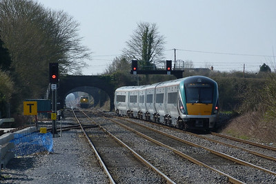 With the terminated 22007 blocking the down platform, 22041 on the 12:30 Dublin Heuston to Westport was diverted to the up platform to pick up its passengers. It is seen here departing for the west, with 076 waiting outside the station. Kildare, Friday, 25/03/11