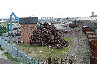 Some workmen scrapping some wagons beside Docklands Station. Friday, 09/03/12