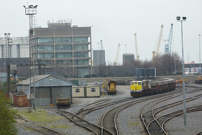 083 in the yard at North Wall with an empty Tara rake. Beside it is a rake of Autoballasters. Wednesday, 14/03/12