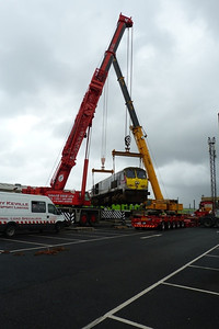With careful co-ordination, 233 passes between the cranes and heads for the low loader. Connolly, Wednesday, 02/11/11
