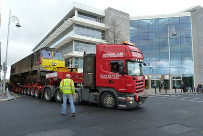 The complicated left hand turn begins for the loco as it passes the offices of the Citi Group in the Dublin's International Financial Services Centre. North Wall Quay, Thursday, 03/11/11