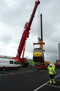 The second crane swinging the rear of 233 around to line it up with the low loader. Connolly, Wednesday, 02/11/11
