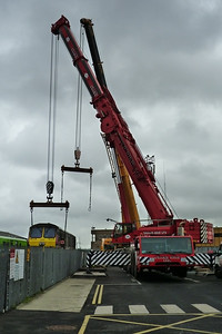 The first crane is attached to 233 and the second is swinging into place. Connolly, Wednesday, 02/11/11