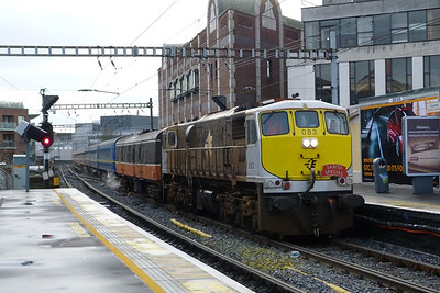 083 leads the Santa Special from Dublin Pearse to Maynooth through Tara Street, Sunday, 11/12/11