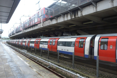 A DLR train departs above the Jubilee line train at Canning Town. Friday, 08/06/12