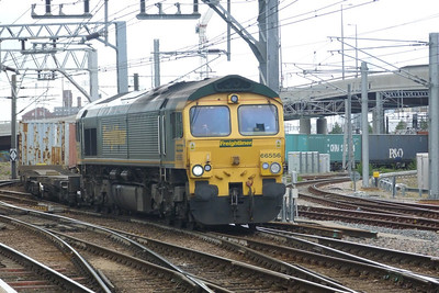 Freightliner's 66 556 comes off the NLL with a liner train. Stratford, Friday, 08/06/12