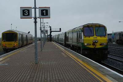 229 arrives with the 12:00 Dublin Heuston to Cork service passing 2702. Limerick Junction, Wednesday, 22/02/12