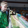 Brayden Follansbee, 8, of Shirley watches model trains on multiple tracks during Railfair '17 hosted by the Nashua Valley Railroad Association at the Ayer/Shirley Middle School on Sunday April 2, 2017. (Sentinel & Enterprise photo/Jeff Porter)