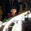 A six year old local named Kadin watches model trains go by as they travel through a sharp light reflecting from the windows above during Railfair '17 inside the Ayer/Shirley Middle School gymnasium on Sunday April 2, 2017.  (Sentinel & Enterprise photo/Jeff Porter)
