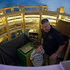 """Thomas Moore, 8,  and father Brian Moore stand inside a helix that delivers model trains through a complex layout depicting the New England Rail during Railfair """"17 in Shirley on Sunday April 2, 2017.  (Sentinel & Enterprise photo/Jeff Porter)"""