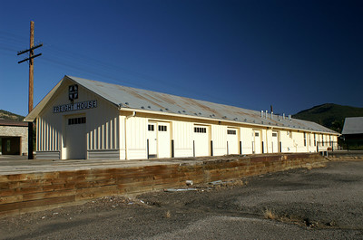 Track side view of freight house in Raton, New Mexico.