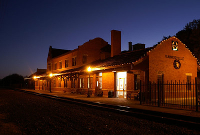 Night shot of the former Santa Fe depot in Gainesville, TX.  Part of the station is used by Amtrak.  The rest is a museum.