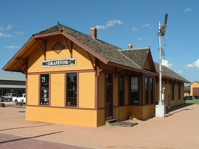 Restored Cotton Belt depot in Grapevine, TX.  Now used as a passenger stop for the Grapevine Historic Railroad.  Former section foreman's house can be seen in background to right of depot.