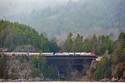5. Fog still lingers over the Adirondacks as Amtrak Toys for Tots train crosses Higby Trestle high above Willboro Bay.