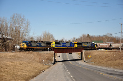 CSX Q62027 with CSXT 254 (AC4400CW), CSXT 7644 (C40-8), and CSXT 608 (CW60AC) southbound on St. Lawrence Subdivision.  QM 129 Route 11 overpass.  March 27th, 2011.