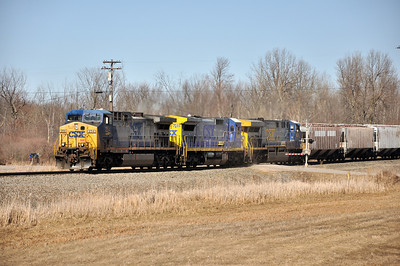 CSX Q62027 with CSXT 254 (AC4400CW), CSXT 7644 (C40-8), and CSXT 608 (CW60AC) southbound on St. Lawrence Subdivision.  Near QM128.  March 27th, 2011