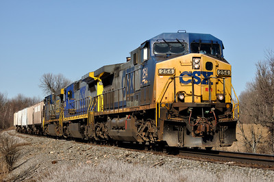 CSX Q62027 with CSXT 254 (AC4400CW), CSXT 7644 (C40-8), and CSXT 608 (CW60AC) southbound on St. Lawrence Subdivision.  QM 114.  March 27th, 2011.