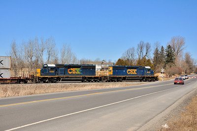 Q62102 at the Route 56 Crossing in Potsdam, NY.  CSXT 8849 and 8150 (pair of EMD SD40-2's, 8849 ex Conrail)  April 3rd, 2011