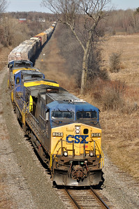 CSX Q62027 with CSXT 254 (AC4400CW), CSXT 7644 (C40-8), and CSXT 608 (CW60AC) southbound on St. Lawrence Subdivision.  QM119.  March 27th, 2011.