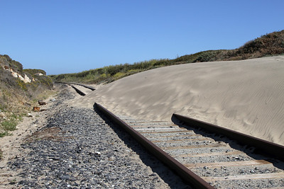 Although the Ocean Shore Railroad was abandoned in 1920, the adjacent Southern Pacific track remained active until the 2009 closure of the Cemex cement plant in Davenport. Pictured here in 2012, the dunes are reclaiming the right-of-way above Liddell Creek Tunnel.