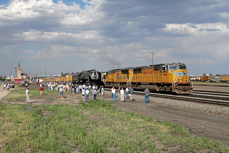 Boarding in Cheyenne while a westbound freight passes