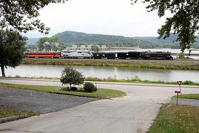 Milwaukee Road 261 northbound at Trempealeau, WI, with Lock & Dam #6 on the Mississippi River