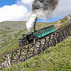 Mt. Washington Cog (New Hampshire) : Mount Washington Cog Railway - Bretton Woods, New Hampshire Photos from June 2008 at the world's first mountain-climbing cog railway, opened in 1869. The 3.1-mile railroad climbs from Marshfield Base Station (elevation 2700') to the summit of Mt. Washington (6288') with an average grade of 25% and max grade of 37.4% (Jacob's Ladder). As of 2008, the Cog operated seven steam locomotives, the oldest dating to 1874, with up to six at a time fired up on weekends. The first diesel was introduced in 2008 to reduce costs and pollution, and by 2010 three more diesels had relegated steam to a single morning run. For more, visit the Cog Railway Website.