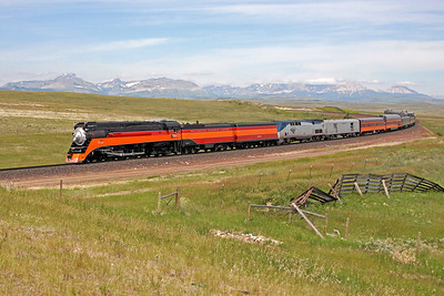 Southern Pacific Daylight 4449 at Browning, Montana (Glacier National Park in distance)