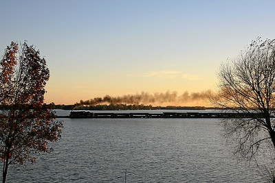 Eastbound Soo Line 1003 crosses Beaver Dam Lake at sunset near Fox Lake, Wisconsin.
