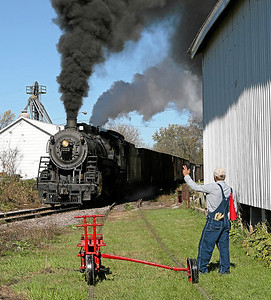 A velocipede takes the siding at Brandon to let Soo Line 1003 head south through town.