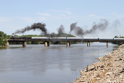 Iowa Interstate QJ 6988 crosses the Mississippi River from Rock Island to Arsenal Island, approaching the Government Bridge to Davenport, Iowa