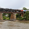 Iowa Interstate QJ 6988 crosses the Iowa River westbound at Iowa City