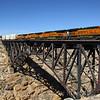 An Eastbound hotshot intermodal train is seen barreling across the Arizona desert crossing the 544-foot bridge at Canyon Diablo, 10-10-20.