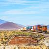 An Eastbound hotshot intermodal train is seen barreling across the Arizona desert about to cross the 544-foot steel bridge over Canyon Diablo, 10-10-20.